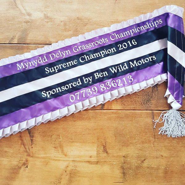 Purple and white sash