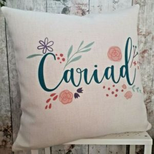 linen effect cushion printed with the word cariad