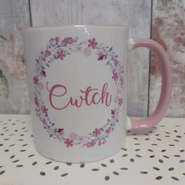 white ceramic mug printed with the welsh word cwtch