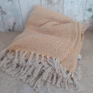 scandi mustard blanket with tassels