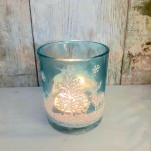 blue tealight holder with glittery Christmas scene