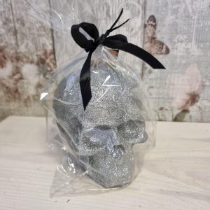 silver glittery skull candle
